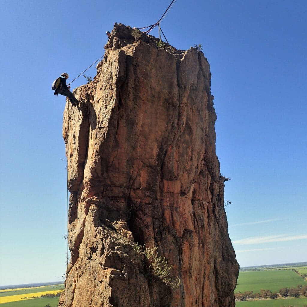 Abseiling from the top of D-Minor, Mount Arapiles